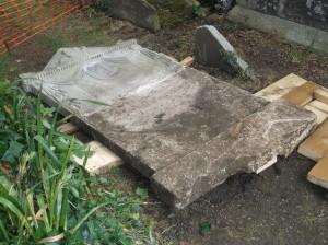 The darker bottom half of this stone was below ground