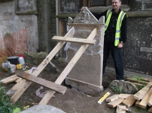 The headstone was propped in position while the cement footings dried