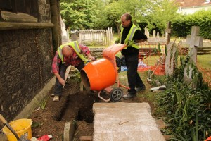 Andy and Mark prepared a new footing for the headstone