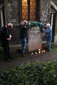 Revealing the restored headstone carved by the Carter family of sculptors