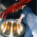 The Millennium Bell being hung in the tower with the other five, to ring in the year 2000
