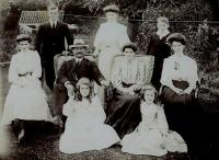 Jock and Isabella with children Jenny, Lizzie, Isabella, John, James, Peggy, and Dora. John is standing, back left